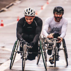 Two Cyclists on Wheelchair Running on Each Other.